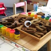 kids table set for active learning of alphabet with letter blocks and playdough