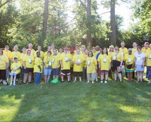 A large group picture of adults with disabilities and their friendsoutside.