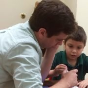 buddy and child working on a Sunday School activity