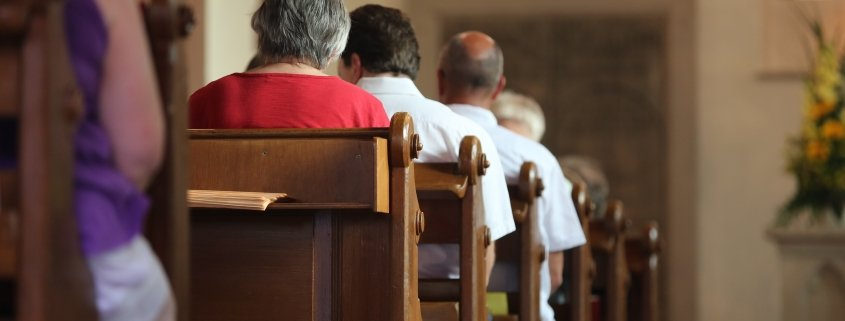 people sitting in pews at church