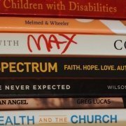 stack of books about autism and family life with disability