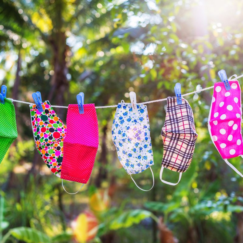 image of face masks hanging to dry on clothesline