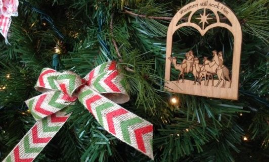 Christmas tree branches with a bow and ornament