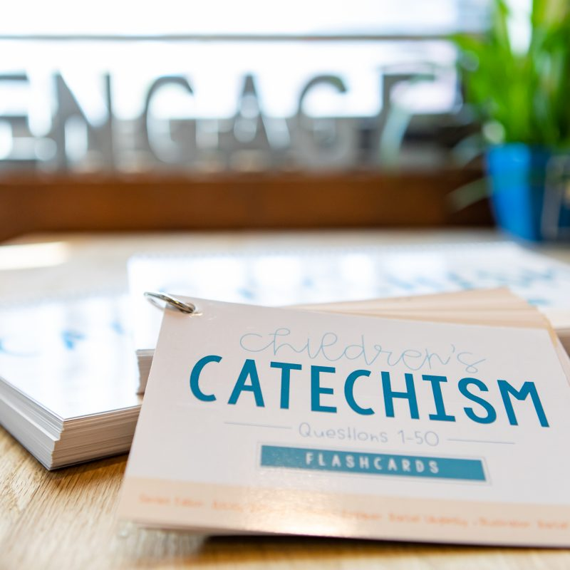 catechism classroom book and flashcards laying on table