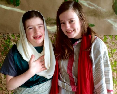 two girls acting out Bible story