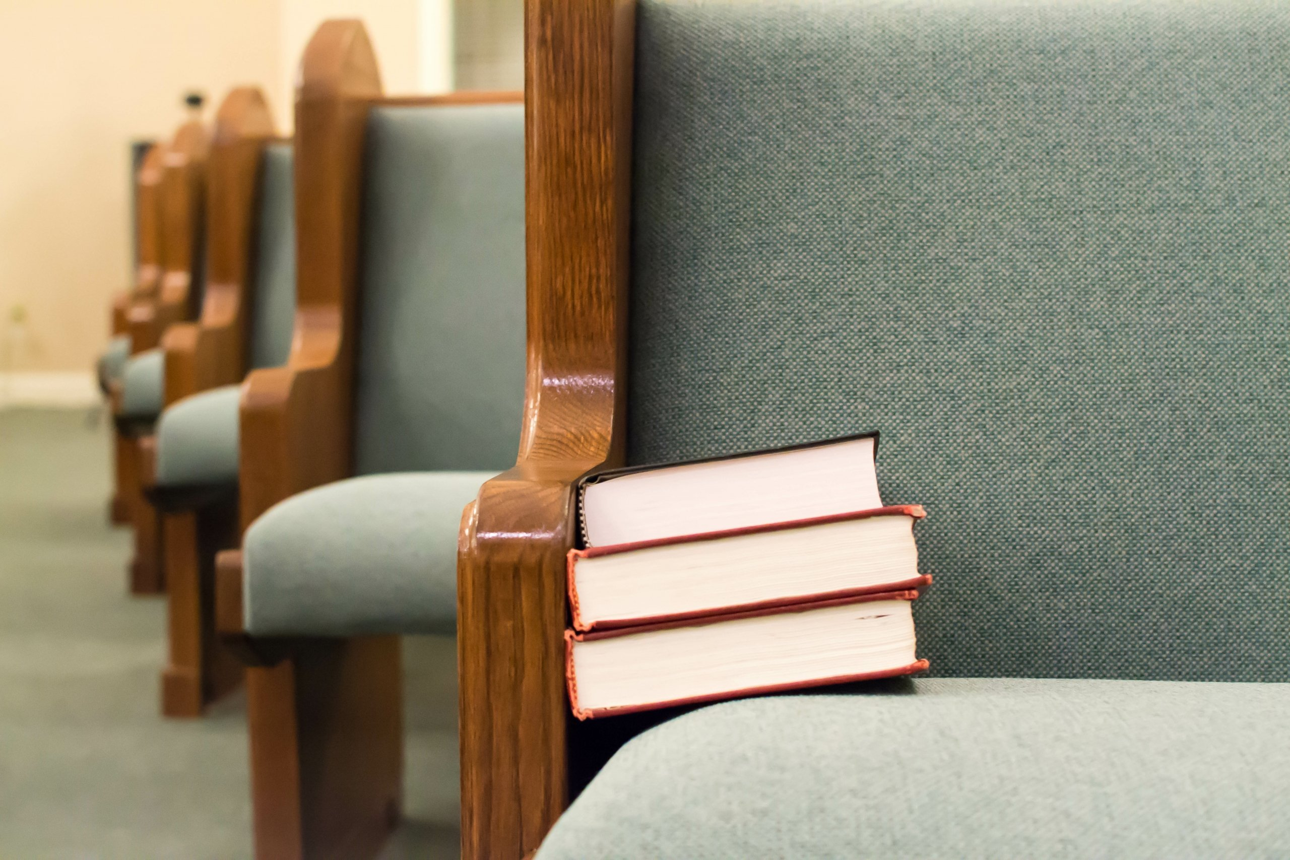 Books stack on church pew