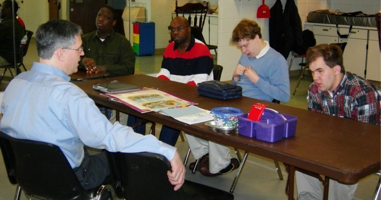 Joel Wallace teaching a class with young men with special needs