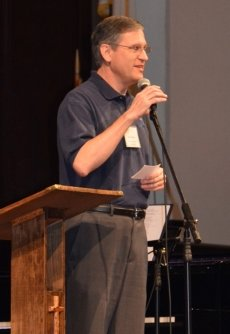 Joel Wallace speaking at a conference