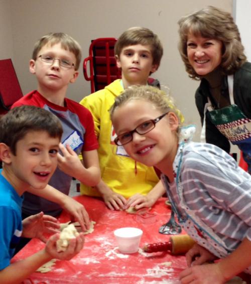 kids making cookies at church