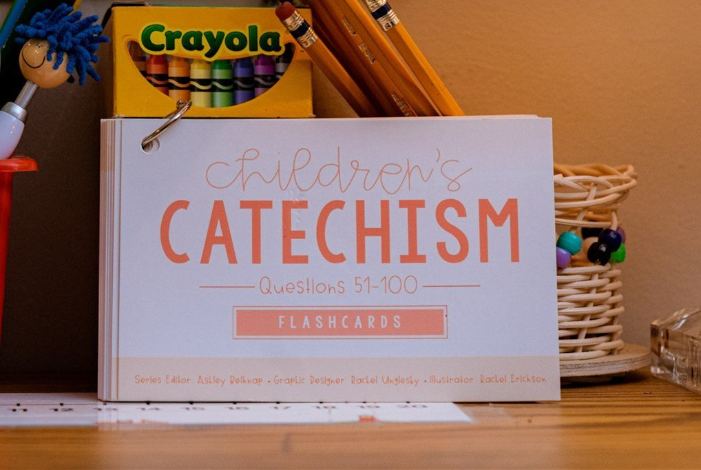 Children's Catechism Flashcards 51-100 sitting on a table