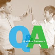 Q&A logo over image of adult man and boy giving a high five